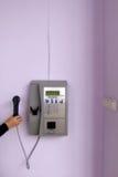 Telefono di paga sulla parete fotografia stock
