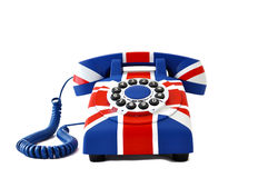 Telefono di Union Jack con il modello della bandiera di Britannici isolato su fondo bianco Fotografia Stock Libera da Diritti