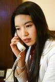 Telefono domestico della donna dell'ufficio fotografia stock libera da diritti