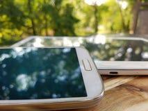 Telefono e compressa Immagini Stock