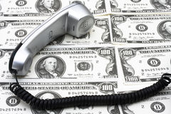 Telefono e soldi Immagini Stock