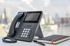 Telefono e taccuino del IP Immagini Stock