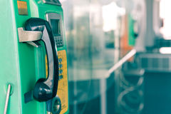 Telefono a gettone o moneta e carta del telefono pubblico in Tailandia Immagine Stock