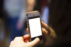 Telefono in mani al fotografie stock libere da diritti