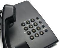 Telefono metallico classico su un fondo bianco Telefono composto a mano sollevato fotografie stock libere da diritti