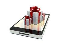 Telefono mobile con i regali liberi Immagini Stock Libere da Diritti