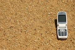 Telefono mobile delle cellule in deserto Immagini Stock