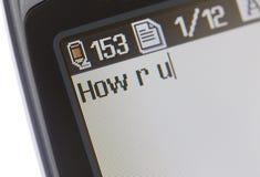 Telefono mobile di invio di messaggi di testo Immagini Stock Libere da Diritti