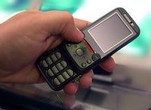 Telefono mobile a disposizione Immagini Stock Libere da Diritti