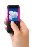 Telefono mobile a disposizione Fotografia Stock