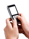 Telefono mobile nelle mani dello schermo in bianco Immagini Stock Libere da Diritti