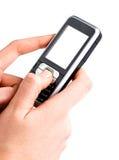 Telefono mobile nelle mani dello schermo in bianco Immagini Stock