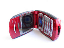 Telefono mobile rosso aperto sopra una priorità bassa bianca Fotografie Stock Libere da Diritti