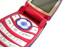Telefono mobile rosso sopra una priorità bassa bianca Fotografia Stock