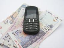 Telefono mobile sui bordi Fotografie Stock Libere da Diritti