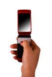 Telefono mobile in una mano femminile Fotografie Stock