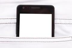 Telefono moderno in schermo di visualizzazione della tasca dei jeans Immagini Stock