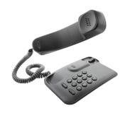 Telefono nero con il microtelefono di galleggiamento fotografia stock