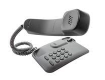 Telefono nero con il microtelefono di galleggiamento immagini stock libere da diritti