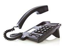 Telefono nero con il microtelefono di galleggiamento immagine stock