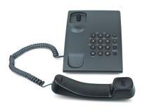 Telefono nero con il microtelefono vicino immagini stock libere da diritti