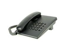 Telefono nero dell'ufficio con il su gancio del microtelefono isolato immagine stock libera da diritti