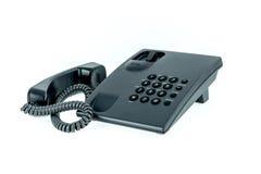 Telefono nero dell'ufficio con vicino del microtelefono isolato immagine stock libera da diritti