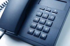 Telefono nero dell'ufficio isolato Immagine Stock