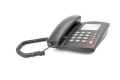 Telefono nero dell'ufficio isolato su bianco Fotografia Stock Libera da Diritti