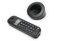 Telefono per le chiamate alle linee urbane ed interurbane su un fondo bianco fotografia stock