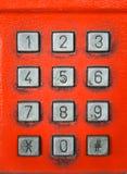 Telefono pubblico di vecchio numero del bottone Immagine Stock