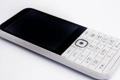 Telefono a pulsante su un fondo bianco Fotografia Stock Libera da Diritti