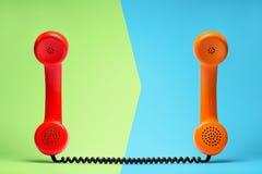 Telefono rosso ed arancio nel retro stile Fotografie Stock