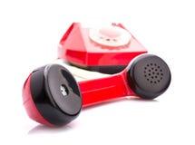 Telefono rosso su bianco fotografia stock