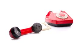 Telefono rosso su bianco fotografia stock libera da diritti