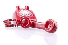 Telefono rotativo rosso dell'annata (con il percorso di residuo della potatura meccanica) Immagine Stock Libera da Diritti