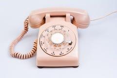 telefono rotatorio crema degli anni 60 Fotografia Stock