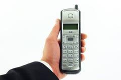 Telefono senza cordone a disposizione isolato su bianco Immagini Stock Libere da Diritti