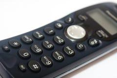 Telefono senza cordone sui precedenti bianchi Fotografia Stock Libera da Diritti