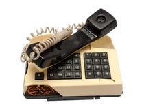 Telefonsammlung - zerschmettertes Telefon auf weißem Hintergrund Stockbilder