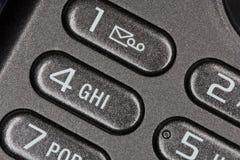 Telefontasten mit Meldungikone Stockbilder