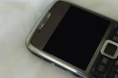 Telefonu komórkowego zakończenie na białym tle fotografia stock