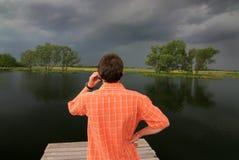 Telefoon bij het meer Stock Afbeelding