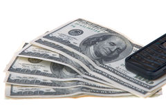 Telefoon en dollars Stock Foto's