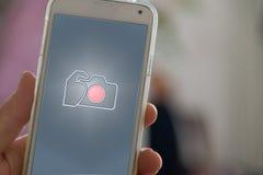 Telefoon en hand Stock Afbeeldingen