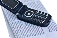 Telefoon en pers Stock Afbeelding