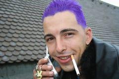 Telefoon en sigaret Stock Foto's