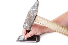 Telefoon nailes met een hamer Stock Afbeeldingen