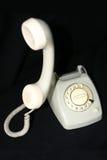 Telefoongesprek - het is voor u Stock Afbeeldingen