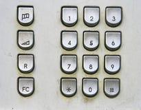 Telefoontoetsenbord in openbare telefoon stock afbeeldingen